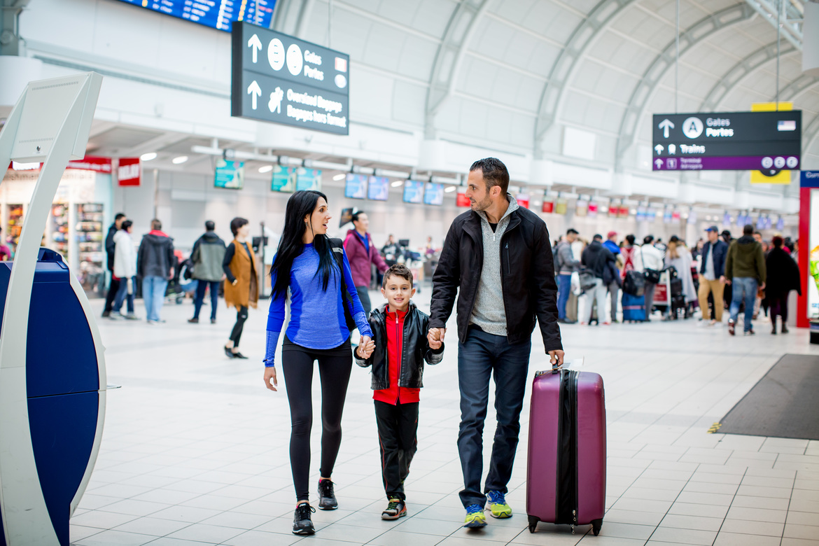 Family walking through Pearson International Airport Terminal